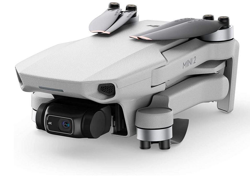 le drone DJI Mini 2 pro plie de couleur gris argente avec sa camera 4k Photo 12MP